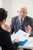 picture of conversation  - Aged unhappy interviewer on job conversation - JPG