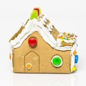 stock photo of gingerbread house  - handmade gingerbread house on the white background - JPG