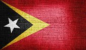 East Timor flag on burlap fabric