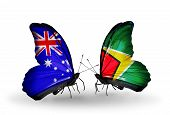 Two Butterflies With Flags On Wings As Symbol Of Relations Australia And Guyana