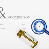 Medical Prescription Andl Pills And Stethoscope On Table