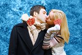 Christmas, Valentines Day, Winter And People Concept - Happy Pretty Young Couple In Love Kissing In