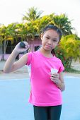 picture of shuttlecock  - Cute little girl holding badminton racket and shuttlecock Outdoor - JPG