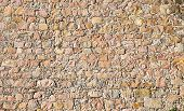 picture of stonewalled  - Background from a brown historic stonewall of an old fortress - JPG
