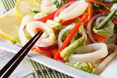pic of squid  - Japanese salad with vegetables and squid rings close - JPG
