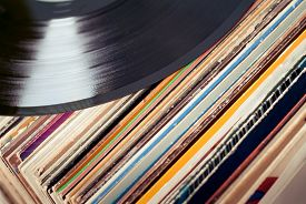 picture of lp  - an old dusty collection of vinyls with one LP at the top  - JPG