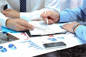 foto of summary  - business colleagues working together and analyzing financial figures on a graphs - JPG