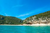picture of shoreline  - Cala Gonone shoreline on a clear day Sardinia - JPG