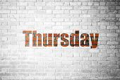 picture of thursday  - Red Brick wall texture background with a word Thursday - JPG