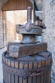 image of wine-press  - old wooden manual press used to press the grapes and make wine in Italy - JPG