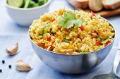 picture of saffron  - saffron rice with vegetables and cilantro on a blue background - JPG