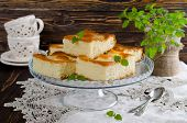 picture of sponge-cake  - Cut the slices of sponge cake with pineapple rings on a wooden table - JPG