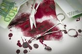 stock photo of bullet  - Surgical composition with bullets blood bandage and money - JPG