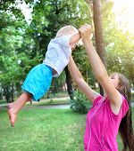 picture of rapture  - Young Mother and Happy Child in the Summer Park - JPG