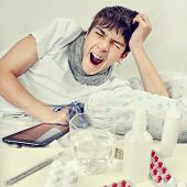 picture of yawn  - Toned Photo of Sick Young Man Yawn on the Bed - JPG
