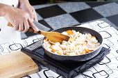 stock photo of pork  - Chef putting slice pf pork to the pan for cooking Japanese pork curry  - JPG