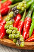 stock photo of red hot chilli peppers  - Red chilli peppers and other pepper - JPG