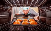 picture of oven  - Chef prepares pastries in the oven - JPG
