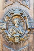 stock photo of pilaster  - carved wooden portal of an italian church - JPG