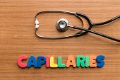 picture of capillary  - Capillaries colorful word with Stethoscope on wooden background - JPG