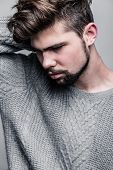 foto of pullovers  - Portrait of a young man in gray pullover - JPG