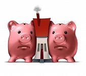 stock photo of social housing  - Housing crunch and home crisis concept as two piggy banks putting the squeeze on a family house as an economic symbol of feeling financial pressure and finance stress from realestate mortgage prices and renovation expenses - JPG