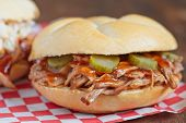 foto of pulling  - Barbeque Pulled Pork Sandwich on a table - JPG
