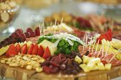 pic of catering service  - Catering service with various fruits and vegetables on wooden plate - JPG