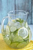 foto of pitcher  - Fruit water with lemon, lime, cucumber and mint in glass pitcher