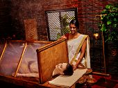 foto of sauna  - Woman having Ayurvedic sauna with steam treatment - JPG