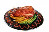stock photo of red meat  - roast red beef meat bbq bloc served on black plate  with green chives and red hot pepper on black plate isolated over white background - JPG