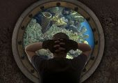 stock photo of ironclad  - Captain looks out the window of the submarine - JPG