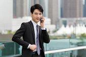 foto of manger  - Asian businessman chat on cellphone - JPG