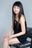 stock photo of shy girl  - Shy Asian girl smiling - JPG