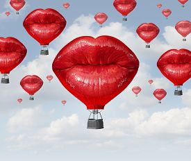 stock photo of surrealism  - Love balloons as a hot air balloon made of human red lips soaring up to the blue sky as a surreal dreamy romantic passion concept and emotional trip or freedom discovery travel - JPG