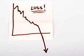 stock photo of going out business sale  - close up of a note paper with finance business graph going down - JPG