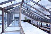 contemporary blue glass hallway inside business office center