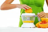 squeeze juice from oranges