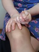 The Women'S Hands On The Naked Knees