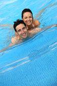 Happy couple swimming