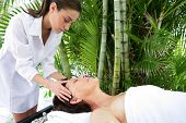 image of beautiful senior woman  - Portrait of a senior woman being massaged - JPG