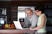 Portrait of a senior couple with a laptop computer