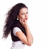 portrait of a beautiful woman with curly long hair isolated over white