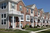 stock photo of front-entry  - Row of brick townhouses with covered entries - JPG
