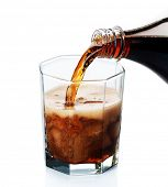 Pouring Cola isolated on white
