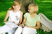 pic of girl reading book  - Two School Girls Reading the Book outdoor - JPG