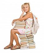 Education Concept.School Girl sitting on the stack of books.
