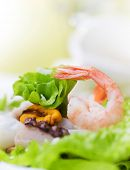 Healthy Seafood Salad with shrimps,octopus and mussels.