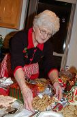 foto of christmas cookie  - a happy grandmother prepares to entertain family and friends at christmas - JPG