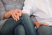 Couple sitting hand in hand